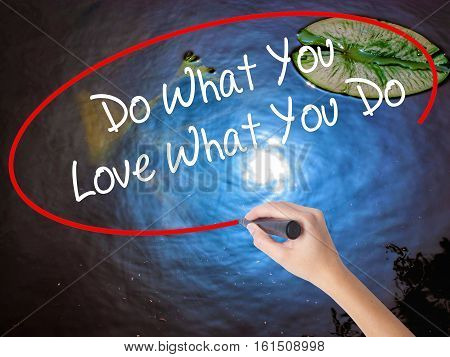 Woman Hand Writing Do What You Love What You Do With Marker Over Transparent Board