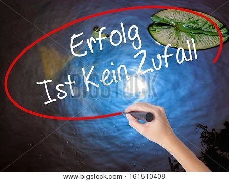 Woman Hand Writing Erfolg Ist Kein Zaufall (success Is No Accident In German) With Marker Over Trans