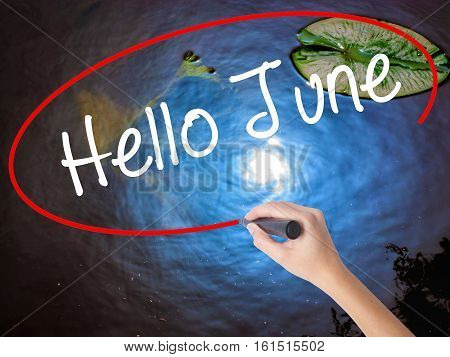 Woman Hand Writing Hello June  With Marker Over Transparent Board