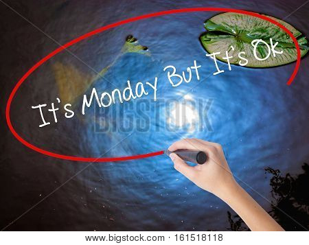 Woman Hand Writing It's Monday But It's Ok With Marker Over Transparent Board