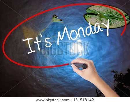 Woman Hand Writing It's Monday With Marker Over Transparent Board