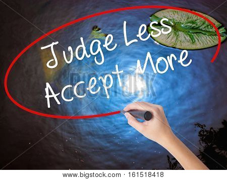 Woman Hand Writing Judge Less Accept More With Marker Over Transparent Board
