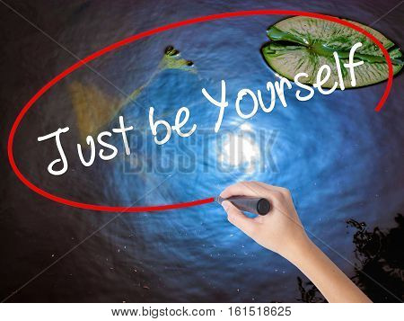 Woman Hand Writing Just Be Yourself With Marker Over Transparent Board
