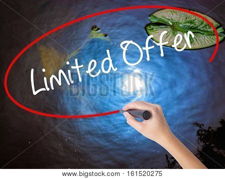 Woman Hand Writing Limited Offer With Marker Over Transparent Board