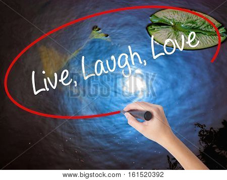 Woman Hand Writing Live Laugh Love With Marker Over Transparent Board