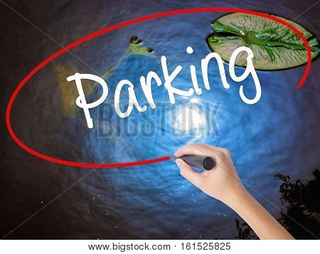 Woman Hand Writing Parking With Marker Over Transparent Board