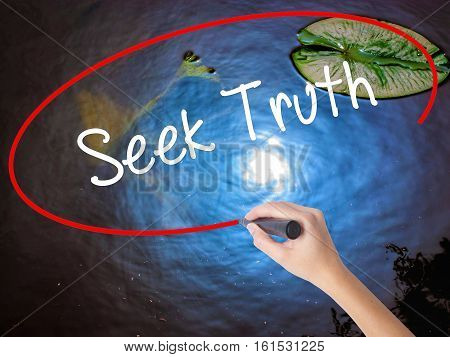 Woman Hand Writing Seek Truth With Marker Over Transparent Board