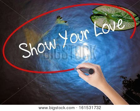 Woman Hand Writing Show Your Love With Marker Over Transparent Board