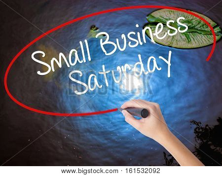 Woman Hand Writing Small Business Saturday With Marker Over Transparent Board