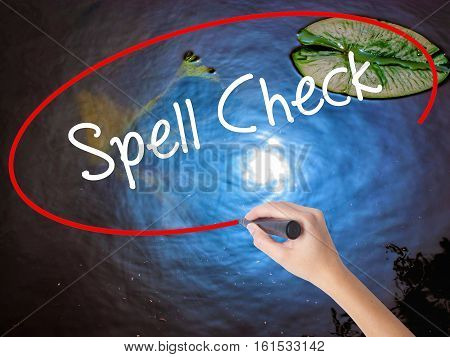 Woman Hand Writing Spell Check  With Marker Over Transparent Board