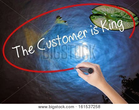Woman Hand Writing The Customer Is King With Marker Over Transparent Board