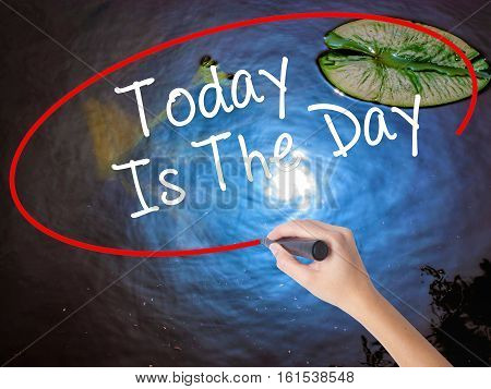 Woman Hand Writing Today Is The Day With Marker Over Transparent Board