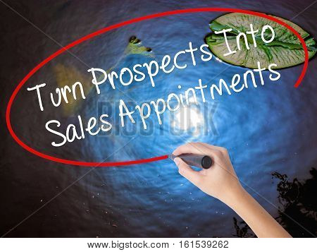 Woman Hand Writing Turn Prospects Into Sales Appointments With Marker Over Transparent Board.