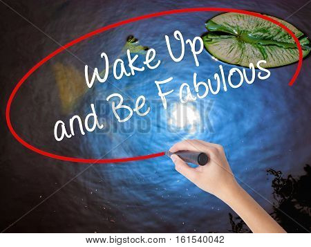 Woman Hand Writing Wake Up And Be Fabulous With Marker Over Transparent Board