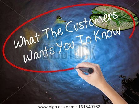 Woman Hand Writing What The Customers Wants You To Know With Marker Over Transparent Board