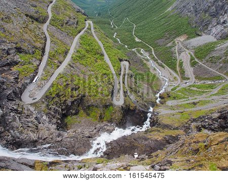 Dangerous serpentine mountain road in Norway summer sunny day landscape