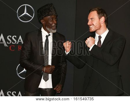 NEW YORK-DEC 13: Michael K. Williams (L) and Michael Fassbender attend the screening of