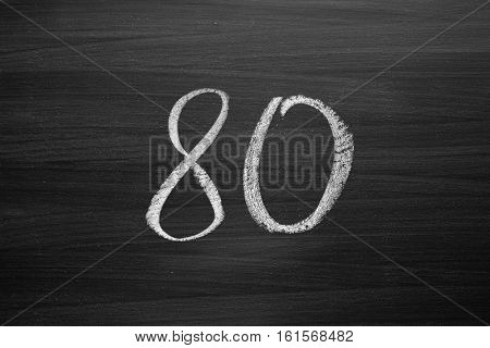 number eighty enumeration written with a chalk on the blackboard