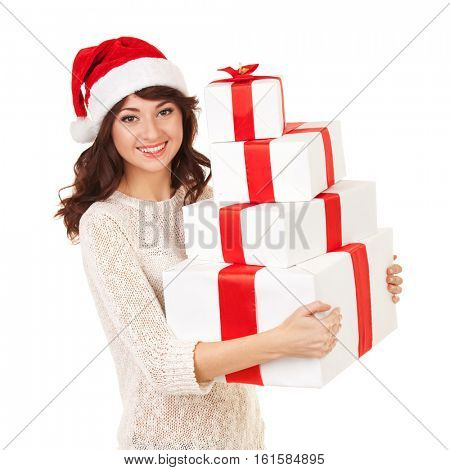 Happy santa woman with gift boxes isolated on white. Smiling model in santa hat posing at studio with gifts. Christmas, xmas, winter, happiness concept. Santa girl hold white gift boxes with red tapes