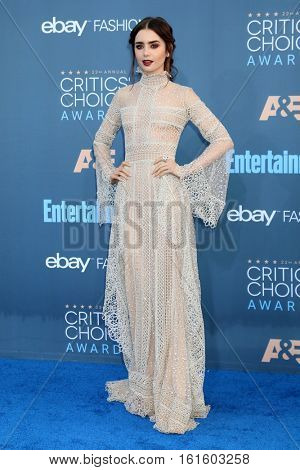 LOS ANGELES - DEC 11:  Lily Collins at the 22nd Annual Critics' Choice Awards at Barker Hanger on December 11, 2016 in Santa Monica, CA