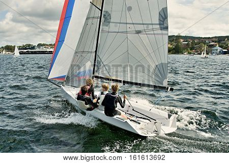 High School Sailing Championships at Belmont Lake Macquarie New South Wales Australia. sail sailing children children sailing child sailors water water sport lake competing competition yacht racing yacht race colors colours having fun sailing coastal spor