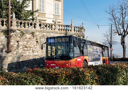 BERGAMO, ITALY - DECEMBER 2016: City bus is driving to Old Town Citta Alta of Bergamo town in Italy