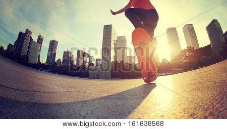 one young skateboarder skateboarding at sunrise city