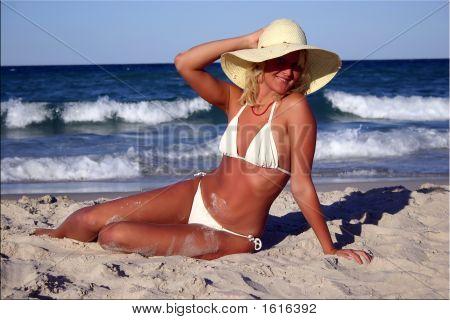 Sexy Blond Suntanned Girl On The Beach