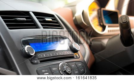 Transportation vehicle and car auto audio radio concept - Car audio and radio stereo system on car panel with flare light effect and copy space