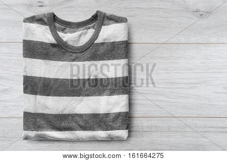 Gray striped sweatshirt closeup on wooden background