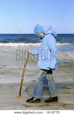 Girl Walking At Baltic Sea