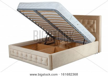 Pull up storage bed storage space revealed by lifting the slatted base isolated on white background include clipping path.