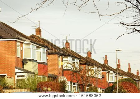 real estate roofs and chimneys under a dull sky
