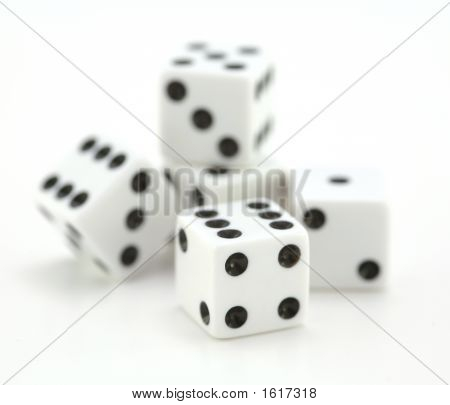 Rolling Dice On White Background - Shallow Depth Of Field