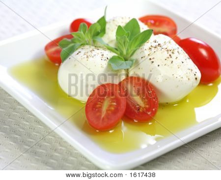 Bocconcini Cheese With Fresh Baby Tomato And Olive Oil