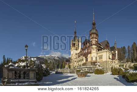 Sinaia Romania - December 4 2016: Peles castle a masterpiece of Neo-Renaissance architecture built between 1873 and 1914 the first European castle entirely lit by electrical current.