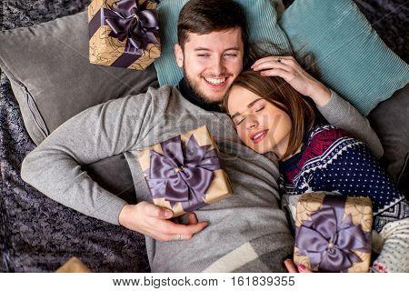 Couple Of Lovers Lying On The Sofa. Christmas Time