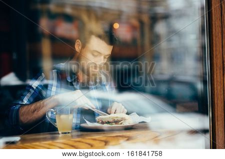 Handsome Young Man Having Lunch In Elegant Restaurant Alone