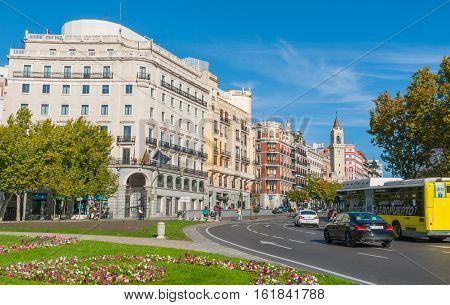 Madrid, Spain - November 9th, 2013:    People, citizens and tourists alike, wait cross the Street, Calle de Alcia in Madrid, Spain.