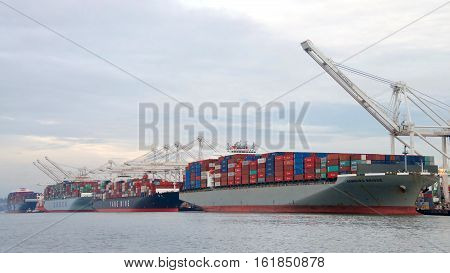 Oakland CA - December 13 2016: The Port of Oakland loads and discharges more then 99 percent of containerized goods moving through Northern California the nations fourth largest metropolitan area.