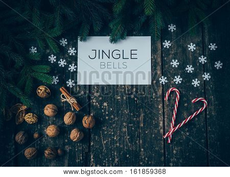 Merry Christmas and Jingle Bells on wood Background