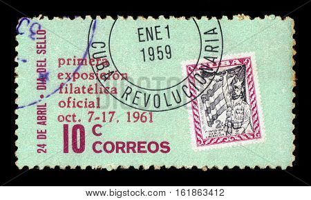CUBA, CIRCA 1961: stamp printed in Cuba , shows freedom fighter in front of flag, opening philatelic exhibition in Havana, circa 1961