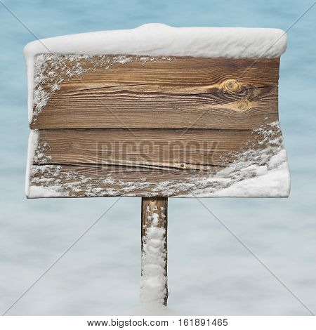 Wooden Sign With Snow On It And Snow Bg