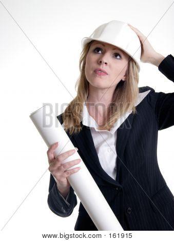 Architect Holding On To Hard Hat
