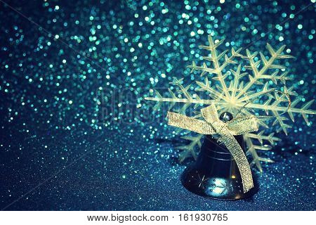 Blue Christmas holiday jingle bell ribbon bow and snowflake