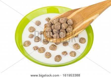 Bamboo Spoon Above Bowl With Yogurt And Extruded Rye Bran