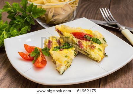 Frittata in Italian on a wooden table. Top view