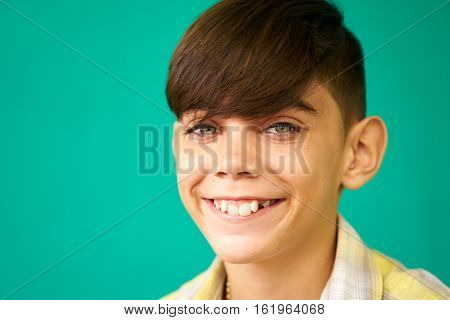 Real Cuban people and feelings portrait of happy young latino kid from Havana Cuba looking at camera and smiling. Child face