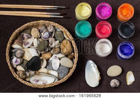 Hand-painted colorful dot patterns on sea pebbles and shells. Children's art project a craft for children. DIY concept. Step by step photo instructions. Step 1. Preparation of materials and tools