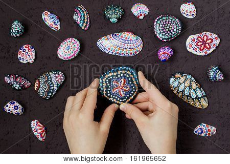 Hand-painted colorful dot patterns on sea pebbles and shells. Children's art project a craft for children. DIY concept. Step by step photo instructions. Step 5. The result of painting